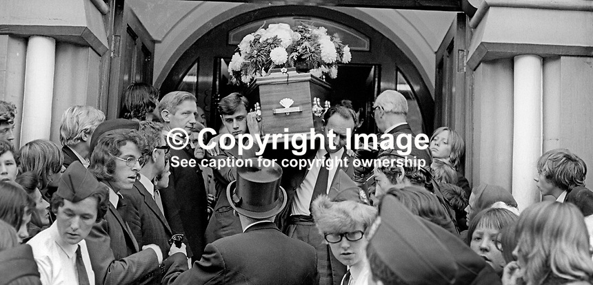 Funeral of missing Belfast, N Ireland, schoolboy, Brian McDermott, whose body was found a week after he went missing between school and home on 2nd September 1973. His coffin is carried from Mountpottinger Presbyterian Church. 197309120582b<br /> <br /> Copyright Image from Victor Patterson, 54 Dorchester Park, Belfast, UK, BT9 6RJ<br /> <br /> t1: +44 28 9066 1296 (from Rep of Ireland 048 9066 1296)<br /> t2: +44 28 9002 2446 (from Rep of Ireland 048 9002 2446)<br /> m: +44 7802 353836<br /> <br /> e1: victorpatterson@me.com<br /> e2: victorpatterson@gmail.com<br /> <br /> The use of my copyright images is subject to my Terms &amp; Conditions.<br /> <br /> It is IMPORTANT that you familiarise yourself with them. They are available on my website at www.victorpatterson.com.<br /> <br /> None of my copyright images may be used on a website or on television unless they are visibly watermarked, i.e. &copy; Victor Patterson within the body of the visible image. The metadata of images used on the Internet must not be removed.<br /> <br /> Copyright acknowledgment of my images is a condition of use.<br /> <br /> Failure to observe the above conditions will incur a penalty of at least 100% of the agreed fee. <br /> <br /> Web use (maximum size - 400 kb) is extra at currently recommended NUJ rates.
