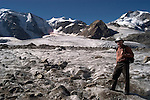 Switzlerland: Hiking the Swiss Glaciers near St. Moritz, taking the Diavolezza Morteratsch hike..Hiker Lee Foster on Pers Glacier..Photo copyright Lee Foster, 510/549-2202, lee@fostertravel.com, www.fostertravel.com..Photo #: swisse11461