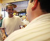 Honolulu, HI - December 26, 2008 -- United States President-elect Barack Obama acknowledges the traveling press, and asks if anyone would like a sandwich at the Koko Head Deli, located at the Koko Head Marina shopping mall Friday, December 26, 2008 in Honolulu, Hawaii. .Credit: Kent Nishimura - Pool via CNP