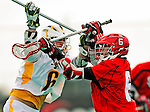 19 March 2011: St. John's University Red Storm Attacker Kieran McArdle, a Freshman from Ronkonkoma, NY, checks University of Vermont Catamount LSM Max Gradinger, a Senior from Rancho Santa Fe, CA at Moulton Winder Field in Burlington, Vermont. The Catamounts defeated the visiting Red Storm 14-9. Mandatory Credit: Ed Wolfstein Photo