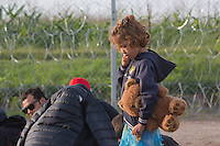 Illegal migrant child with her Teddy bear waits for being detained by police officers after her family crossed the razor wire fence on the border between Serbia and Hungary near Roszke (about 174 km South of capital city Budapest), Hungary on September 15, 2015. ATTILA VOLGYI