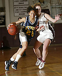 TORRINGTON, CT, 01/04/08- 010408BZ03- Kennedy's Jaleesa Roy (25) drives past Torrington's Lindsey Begay (32) during their game at Torrington High School Friday night.<br /> Jamison C. Bazinet Republican-American
