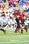 College Park, MD - OCT 1, 2016: Maryland Terrapins quarterback Perry Hills (11) pitches the ball to the running back during game between Maryland and Purdue at Capital One Field at Maryland Stadium in College Park, MD. The Terps got the win 50-7 over visiting Purdue. (Photo by Phil Peters/Media Images International)