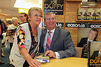 NO FEE PICTURES.15/10/11 Eason, Ireland's leading retailer of books, stationery, magazines and lots more, hosted a book signing by RTE presenter, Joe Duffy. Pictured at Eason,O'Connell Street, Dublin is Joe Duffy who signed copies of his new autobiography Just Joe..Follow Eason on Twitter @easons. Pictured with Joe Duffy is Breda Louhnman, Swords  Pictures:Arthur Carron/Collins