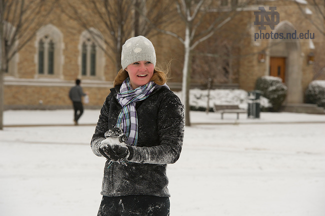Jan. 31, 2013; A Notre Dame student enjoys a snowball fight in South Quad during a snow shower.  Photo by Barbara Johnston/University of Notre Dame