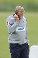 QPR manager Harry Redknapp on the phone