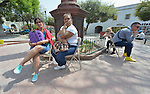 """Cuban immigrants wait in the Plaza Benito Juarez in Nuevo Laredo, Mexico, on March 3, 2017. Hundreds of Cubans are stuck in the border city, caught in limbo by the elimination in January of the infamous """"wet foot, dry foot"""" policy of the United States. They are not allowed to enter the U.S. yet most don't want to return to Cuba. Many of the city's churches have become temporary shelters for the immigrants, and congregations rotate responsibility for feeding the Cubans, who have slowly been forced to appreciate Mexican cuisine. Such solidarity from ordinary Mexicans will be tested in coming months, as not only are the Cubans stuck at the border, but the U.S. has stepped up deportations of Mexican nationals, while at the same time detaining many undocumented workers from other nations and simply dumping them on the US-Mexico border."""