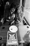 Paul and Linda McCartney Wings Tour 1975. Paul and Linda share a quite moment on their tour bus while traveling  to Cardiff for that night performance. England.