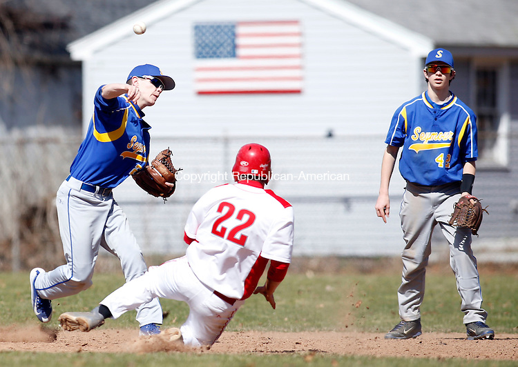 Seymour, CT- 11 April 2015-041115CM16-  Seymour shortstop Matt Vartelas turns a double play as Wolcott's  Todd Manzolli slides into second during their NVL matchup against on Saturday.  Christopher Massa Republican-American