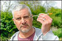 BNPS.co.uk (01202 558833)<br /> Pic: GrahamHunt/BNPS<br /> <br /> Guy with the float that hit him in the eye.<br /> <br /> An angler is urging other fishermen to wear safety googles after he was left permanently blind in one eye following a freak fishing accident.<br /> <br /> Guy Manton, 55, has been told he will never see again in his left eye after his float flew back straight into his face, piercing his pupil and shattering his eyeball.<br /> <br /> When he pulled his hand back from his face he was confronted by a gruesome handful of blood and eye fragments.<br /> <br /> The engineer, from Gillingham, Dorset, suffered a detached retina in the gruesome accident and was rushed to hospital where specialists' attempts to stitch it back together were to no avail.<br /> <br /> Despite this, the father of five has vowed to carry on fishing - which has been his passion for almost 50 years - but he has already bought two pairs of safety googles to protect his one remaining working eye.