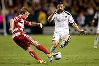 Dema Kovalenko of the LA Galaxy attempts to block a pass by Dax McCarty of FC Dallas. FC Dallas defeated the LA Galaxy 3-0 to win the Western Division 2010 MLS Championship at Home Depot Center stadium in Carson, California on Sunday November 14, 2010.