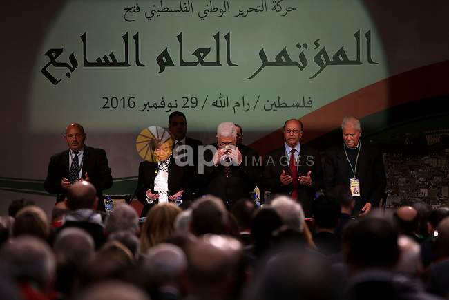 Palestinian president Mahmud Abbas recites the Fatiha or the prayer of the dead, during the opening ceremony of the 7th Fatah Congress on November 29, 2016, at the Muqataa, the Palestinian Authority headquarters, in the West Bank city of Ramallah. Abbas's Fatah re-elected him party head as the movement opened its first congress since 2009 with talk mounting of who will eventually succeed the 81-year-old. Photo by Shadi Hatem