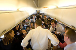 Senator Barack Obama, Democratic presidential candidate, speaks with reporters about his visit that morning to New Orleans, aboard his campaign plane. February 7, 2008
