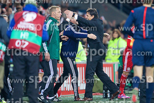 13.10.2014, City Stadium, Cardiff, WAL, UEFA Euro Qualifikation, Wales vs Zypern, Gruppe B, im Bild Wales' manager Chris Coleman celebrates with goalkeeping coach Martyn Margetson after his side beat 2-1 Cyprus // 15054000 during the UEFA EURO 2016 Qualifier group B match between Wales and Cyprus at the City Stadium in Cardiff, Wales on 2014/10/13. EXPA Pictures &copy; 2014, PhotoCredit: EXPA/ Propagandaphoto/ David Rawcliffe<br /> <br /> *****ATTENTION - OUT of ENG, GBR*****