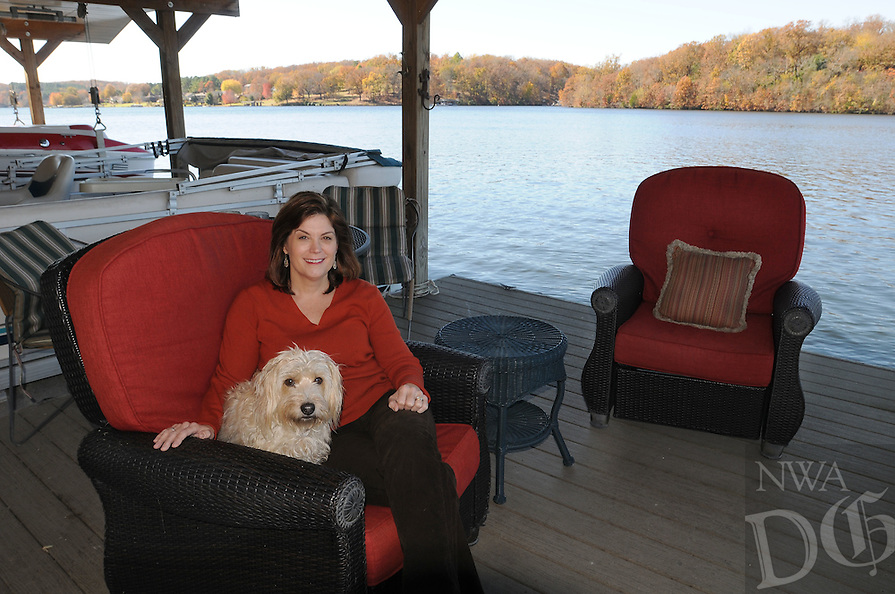 NWA Democrat-Gazette/FLIP PUTTHOFF <br /> Her dock at Lake Windsor in Bella Vista is a favorite space for Lisa Morstad. The setting is calming and therapeutic,and the dock      Nov. 7, 2015       is a great place to share with friends. Her dog, Celie, enjoys it, too.