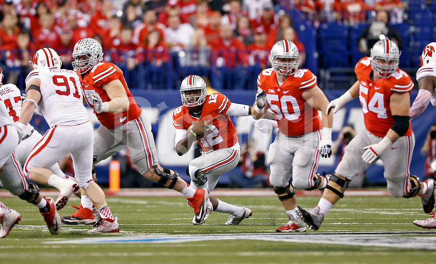 Ohio State Buckeyes quarterback Cardale Jones (12) against Wisconsin Badgers in the 2014 Big Ten Football Championship Game at Lucas Oil Stadium in Indianapolis, Ind. on December 6, 2014.  (Dispatch photo by Kyle Robertson)