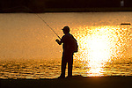 Middletown, New York - A man fishes at sunset in the lake at Fancher-Davidge Park  on May 14, 2014.