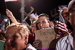 Spectators at a campaign rally for Republican vice presidential candidate Rep. Paul Ryan in Fort Myers, Florida, October 18, 2012.