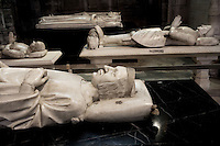 Gisants of Charles V (1338 - 1380), marble, 1374, by Andre Beauneveu, Louis of Sancerre (1341 - 1402), Bertrand du Guesclin (1320 - 1380), Charles VI (1368 - 1422) and Isabeau of Bavaria (1371 - 1435) in the distance, Abbey church of Saint Denis, Seine Saint Denis, France. Picture by Manuel Cohen