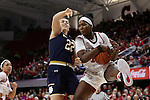 29 December 2016: NC State's Jennifer Mathurin (CAN) (right) grabs a rebound under pressure from Notre Dame's Erin Boley (22). The North Carolina State University Wolfpack hosted the University of Notre Dame Fighting Irish at Reynolds Coliseum in Raleigh, North Carolina in a 2016-17 NCAA Division I Women's Basketball game. NC State won the game 70-62.