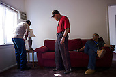 Los Angeles, California<br /> January 29, 2014<br /> <br /> Former homeless WWII veteran Ivan Bennett, 85 was placed in a VA voucher apartment a few days before he receives donated furniture. His VA case worker William Kurts is present when the furniture arrives and tries out the new couch as the lamp is installed.