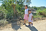 In Zapotal, Mexico, 3-year old Luz Elena Martinez, who is blind, walks home from preschool, which she attends for one hour a day in order to help prepare her to go full time the following year. Luz is walking with her older sister, 5-year old Sandra. Sandra will graduate from preschool the coming year, but before that she's getting Luz accustomed to the school environment to make for an easier transition.
