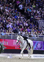 OMAHA, NEBRASKA - MAR 30: Mai Tofte Olesen hugs Rustique after her ride during the FEI World Cup Dressage Final II at the CenturyLink Center on April 1, 2017 in Omaha, Nebraska. (Photo by Taylor Pence/Eclipse Sportswire/Getty Images)