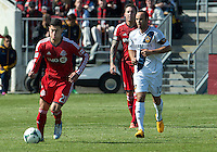 30 March 2013:Toronto FC midfielder Jonathan Osorio #21 and Los Angeles Galaxy midfielder Landon Donovan #10 in action during an MLS game between the LA Galaxy and Toronto FC at BMO Field in Toronto, Ontario Canada..The game ended in a 2-2 draw..
