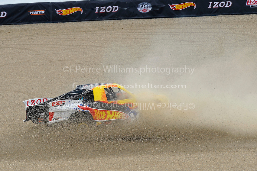 "29 May, 2011, Indianapolis, Indiana, USA .Tanner Foust spins to a stop in the Formuls 1 gravel trap at the end of the  ""Hot Wheels Fearless At The 500"" stunt jump..©2011, F. Peirce Williams."