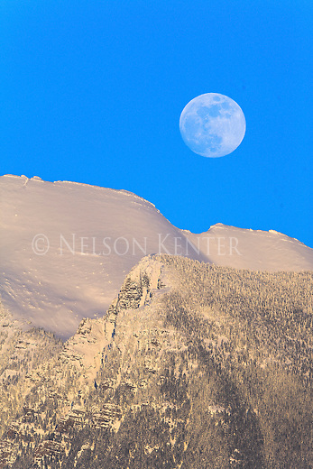 Full moon over the snow covered Mission Mountains