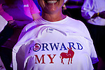 A Romney/Ryan supporter shows off her t-shirt at a campaign rally in Daytona Beach, Florida, October 19, 2012.