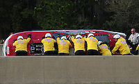 Mar. 9, 2012; Gainesville, FL, USA; NHRA safety safari crew flips over the car of pro mod driver Mike Janis (not pictured) after crashing during qualifying for the Gatornationals at Auto Plus Raceway at Gainesville. Janis would be unhurt in the incident. Mandatory Credit: Mark J. Rebilas-
