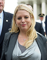Attorney General Pam Bondi (Republican of Florida) departs the United States Supreme Court Building in Washington, D.C. following the third and final day of oral arguments concerning the constitutionality of the Patient Protection and Affordable Care Act on Wednesday, March 28, 2012.  .Credit: Ron Sachs / CNP /MediaPunch