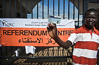 A young man leaves a referendum centre in Juba after receiving his registration card for the January 2011 election when the people of South Sudan will vote in a referendum on independence.