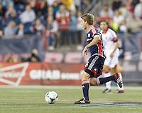 New England Revolution midfielder Scott Caldwell (6) brings the ball forward.  In a Major League Soccer (MLS) match, the New England Revolution (blue) defeated D.C. United (white), 2-1, at Gillette Stadium on September 21, 2013.