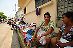 A street vendor sells second hand clothes in the peaceful, hilltop town of Suchitoto, El Salvador..