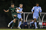 21 November 2013: USF's Samuel Hosseini (GER) (5) sends the ball away from North Carolina's Cooper Vandermaas-Peeler (21) and Omar Holness (JAM) (14). The University of North Carolina Tar Heels hosted the University of South Florida Bulls at Fetzer Field in Chapel Hill, NC in a 2013 NCAA Division I Men's Soccer Tournament First Round match. North Carolina won the game 1-0.