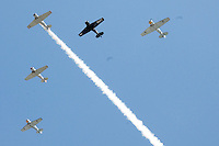 Vintage World War II aircrafts fly over Woodlawn Cemetery in the Missing Man Formation during the 73rd Annual Memorial Day Observance at Woodlawn Cemetery on Monday, May 30, 2011.