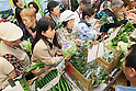 April 14, 2011, Tokyo, Japan - Customers shop for farm products at Japan Agricultural Cooperatives (JA) building in Chiyoda ward, Tokyo on Thursday, April 14, 2011. JA held the event to support farmers in Kanto region like Fukushima prefecture, hurting from dropped sales due to rumours of the spread of radiation from the crippled Fukushima No.1 nuclear power plant. All proceeds will be donated to the victims suffered from the March 11 earthquake and tsunami. (Photo by Yusuke Nakanishi/AFLO) [1090] -ty-