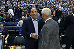 05 February 2017: Notre Dame head coach Mike Brey (left) and UNC head coach Roy Williams (right) meet before the game. The University of North Carolina Tar Heels hosted the University of Notre Dame Fighting Irish at the Greensboro Coliseum in Greensboro, North Carolina in a 2016-17 Division I Men's Basketball game. The game had been postponed one day and moved from Chapel Hill due to a water shortage. UNC won the game 83-76.