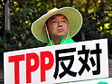 October 26, 2011, Tokyo, Japan - A farmer attends the rally against Japan to take part in the Trans-Pacific Partnership (TPP) negotiations in Tokyo on Wednesday, October 26, 2011. Japan's government is trying to accelerate its decision on whether to join multilateral negotiations for a Pacific-wide trade pact. The TPP is a regional free trade agreement that would in principle eliminate all tariffs within the zone, including on farm products, which have been excluded from Japan's previous free trade deals. Thousands of Japanese farmers marched through central Tokyo to push the government not to join a TPP that will likely hit the nation's small farmers. (Photo by Natsuki Sakai/AFLO) [3615] -ty-