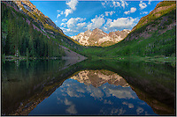 On a perfect June morning, the Maroon Bells are reflected in the calm waters of Maroon Lake in the Maroon Bells Wilderness. This Colorado image comes from one of the most photographed locations in the state, and for good reason. The beauty in this area of the Rocky Mountains is unparalleled.