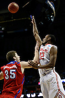 Ohio State Buckeyes forward Sam Thompson (12) puts up a shot over Dayton Flyers forward/center Matt Kavanaugh (35) in the first half of the second-round NCAA Tournament game between the Ohio State Buckeyes and the Dayton Flyers at the First Niagara Center, Thursday afternoon, March 20, 2014. The Dayton Flyers defeated the Ohio State Buckeyes 60 - 59. (The Columbus Dispatch / Eamon Queeney)