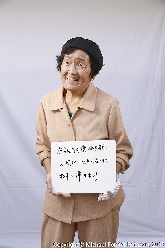 Yuriko Igari, evacuee from Naraha and retired guest house owner living in Iwaki, Fukushima. <br /> <br /> In March 2011, an earthquake and tsunami hit northern Japan and destroyed the Fukushima Daiichi nuclear power plant. Some 488 thousand people evacuated from the three-part disaster; in 2015, nearly 25% remain displaced.<br /> <br /> A massive effort is now underway to decontaminate towns in the Fukushima Exclusion Zone. Thousands of laborers are cleaning or demolishing every building, and removing and incinerating all topsoil in inhabited areas. In the adjacent forests and mountains, radiation levels remain higher and will not be cleaned.<br /> <br /> Naraha, 12 miles south of the nuclear plant, is the first town to reopen after the disaster. Residents were allowed to return home full-time on Sept. 5, 2015. To date, an estimated 100 residents have returned, out of a pre-disaster population of 7,400. <br /> <br /> I returned to Fukushima one week after Naraha reopened and spent a month there, interviewing and photographing returnees and decontamination workers. I asked portrait subjects to write down their hopes and fears for their hometowns, and then discuss these thoughts about their future. People&rsquo;s written declarations often differed substantially from their spoken comments.<br /> <br /> &copy; Michael Forster Rothbart Photography<br /> www.mfrphoto.com &bull; 607-267-4893<br /> 34 Spruce St, Oneonta, NY 13820<br /> 86 Three Mile Pond Rd, Vassalboro, ME 04989<br /> info@mfrphoto.com<br /> Photo by: Michael Forster Rothbart<br /> Date:  9/23/2015<br /> File#:  Canon &mdash; Canon EOS 5D Mark III digital camera frame B15117