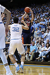 18 February 2017: Virginia's London Perrantes (right) shoots over North Carolina's Luke Maye (left). The University of North Carolina Tar Heels hosted the University of Virginia Cavaliers at the Dean E. Smith Center in Chapel Hill, North Carolina in a 2016-17 Division I Men's Basketball game. UNC won the game 65-41.