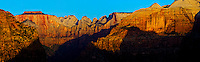 Panoramic view of the Towers of the Virgin, including the Altar of Sacrifice, the Sundial, and West Temple from canyon overlook at dawn. Four image stitched panorama.