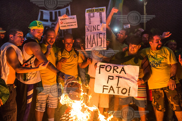 Anti-government protestors, on Copacabana Beach, celebrate by burning an effigy of Dilma Rousseff shortly after they watched on television as deputies of the Lower House of Congress voted to start the impeachment of the president. Now the Senate will vote, in early May, and if they agree with the Lower House then President Rousseff will be suspended for six months pending an impeachment trial, and her rival, vice-president Michel Temer, will take office.