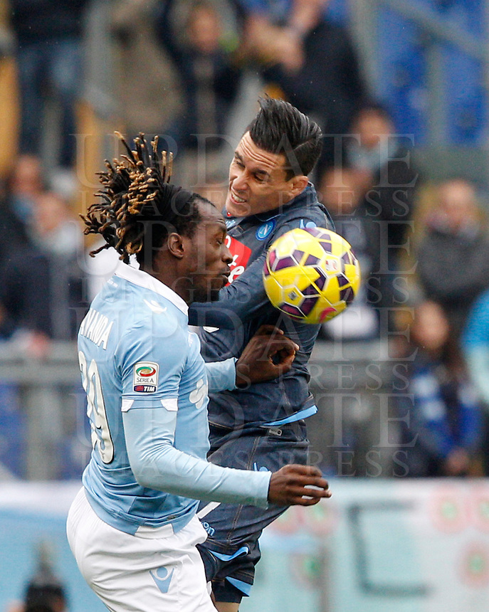 Calcio, Serie A: Lazio vs Napoli. Roma, stadio Olimpico, 18 gennaio 2015.<br /> Lazio&rsquo;s Luis Pedro Cavanda and Napoli&rsquo;s Jose' Maria Callejon, right, jump for the ball during the Italian Serie A football match between Lazio and Napoli at Rome's Olympic stadium, 18 January 2015.<br /> UPDATE IMAGES PRESS/Riccardo De Luca