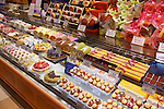 Cakes, rolls and pastries on a display at a Japanese bakery. Tokyo, Japan.