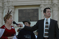 """Singer Johnny Hochgraefe listens as members of the audience sing parts of the chorus to """"The Twelve Days of Christmas"""" during the Annual Christmas Sing-Along at the Spreckels Organ Pavillion in Balboa Park on Sunday December 23, 2007."""
